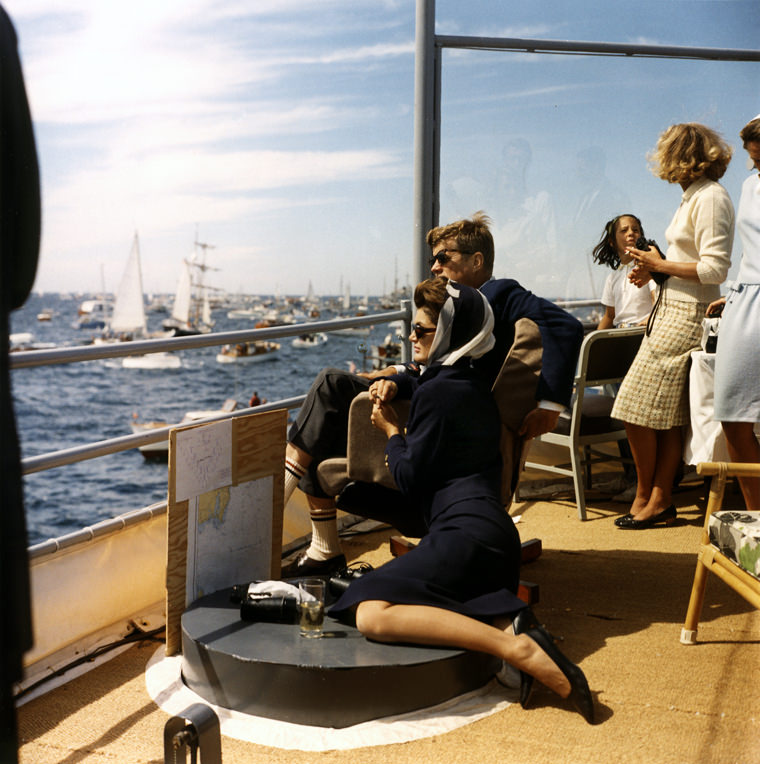 JFK and Jackie Kennedy watch the first race in the 1962 America's Cup from aboard the USS Joseph P. Kennedy Jr., off Newport, Rhode Island. Photograph by Robert Knudsen, White House, in the John F. Kennedy Presidential Library and Museum, Boston. 15 September 1962 / KN-C23943
